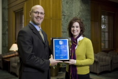 """Dale Pfrimmer and Heidi Shedenhelm, Department of Nursing Administration, accept the """"Best Workplace for Men in Nursing"""" award"""