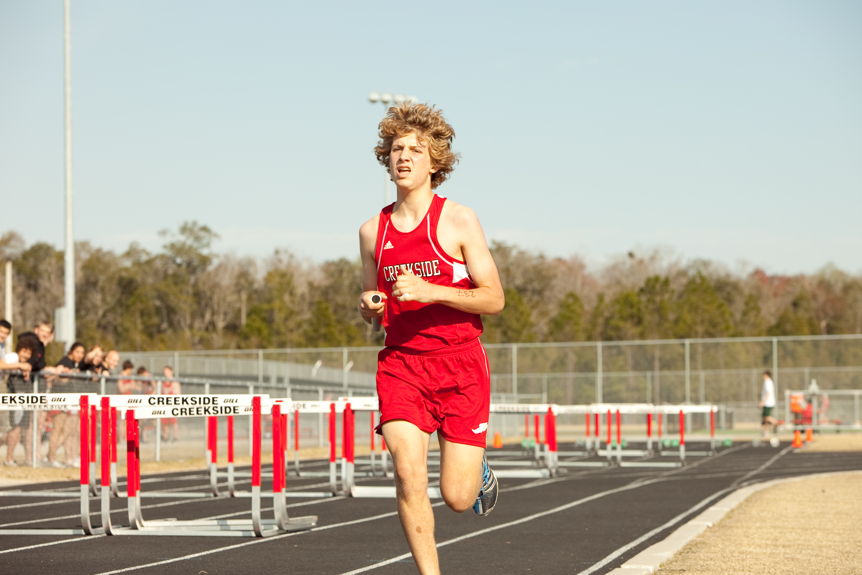 Ben Thiemann running track and field.