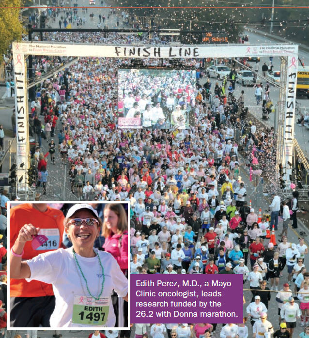 Edith Perez, M.D., a Mayo Clinic oncologist, crossing the finish line of the 26.2 with Donna Marathon