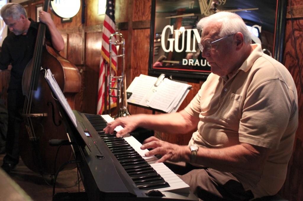 John Thomas playing the piano