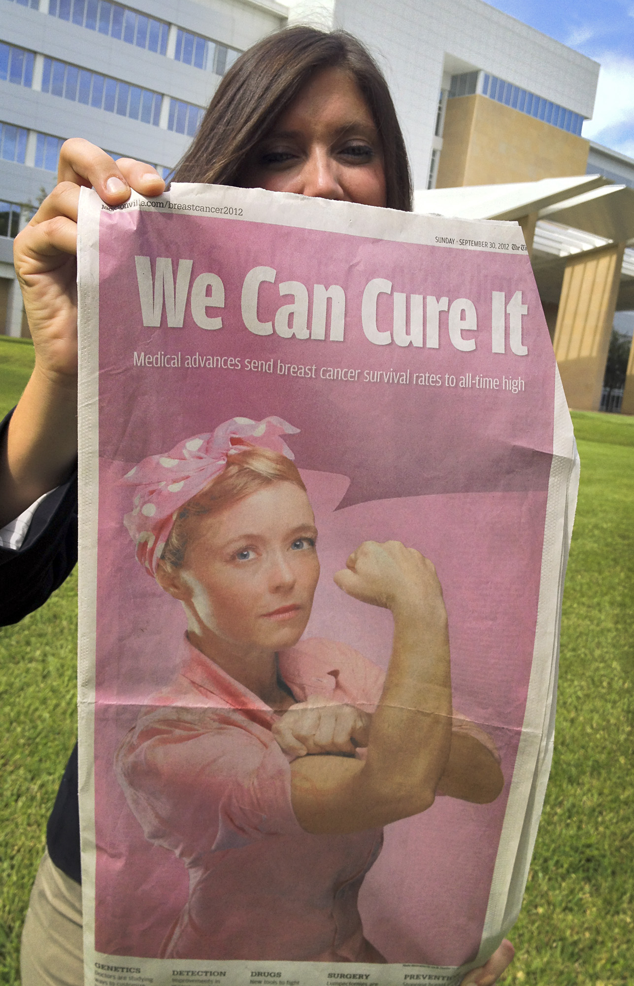 """Female outside of Mayo Clinic in Florida holding a copy of The Florida Times-Union's """"Breast Cancer 2012: We Can Cure It"""" special section."""