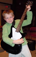 Jacob Harpel holding a guitar