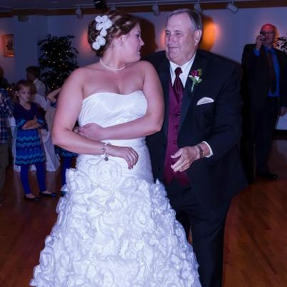 Amy on her wedding day and her dad Chuck