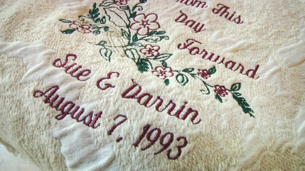 """blanket that reads """"From this day forward Sue and Darrin, August 7, 1993"""""""