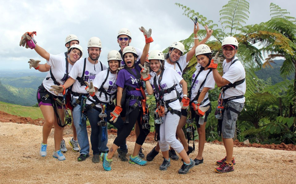 Dorylee Baez (in purple) and a group of friends and supporters enjoy a zip lining adventure at Toro Verde in Orocovis, Puerto Rico.