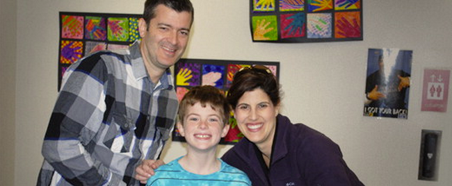 Traci Downs with her husband, Hunter, and son, Aidan