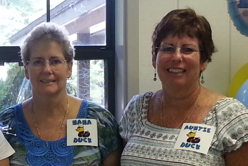 Two sisters stand next to each other, Terri McMillan on the left and Tammi Cummings on the right