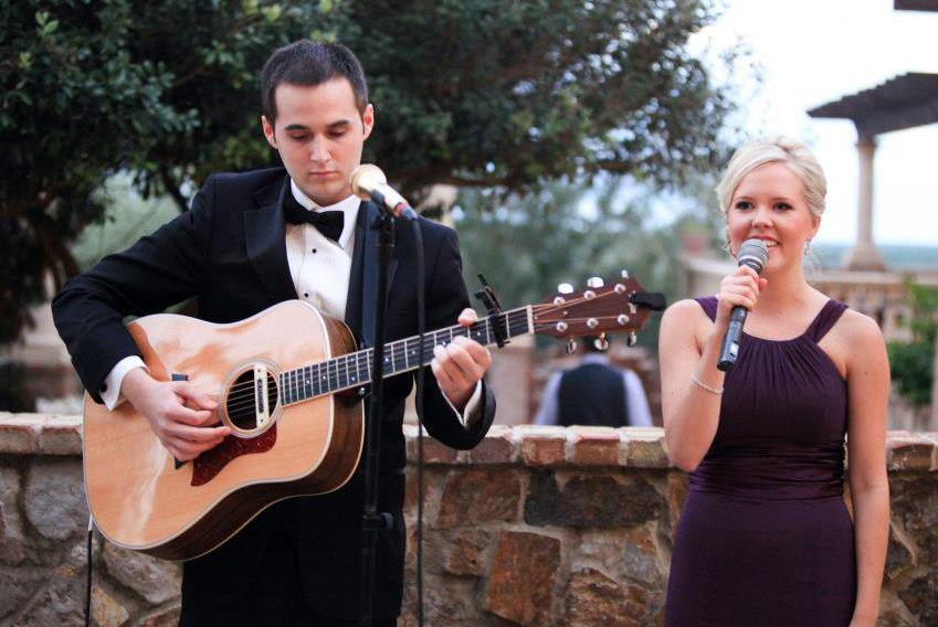 Todd Blake plays guitar as his wife Maja sings.