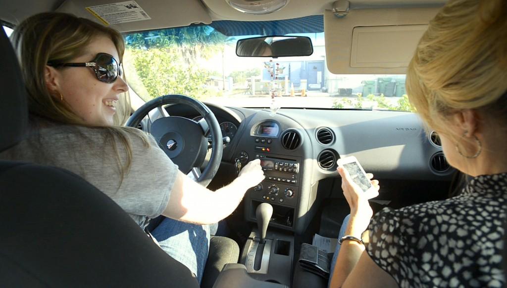 Nicole Dehn driving her car