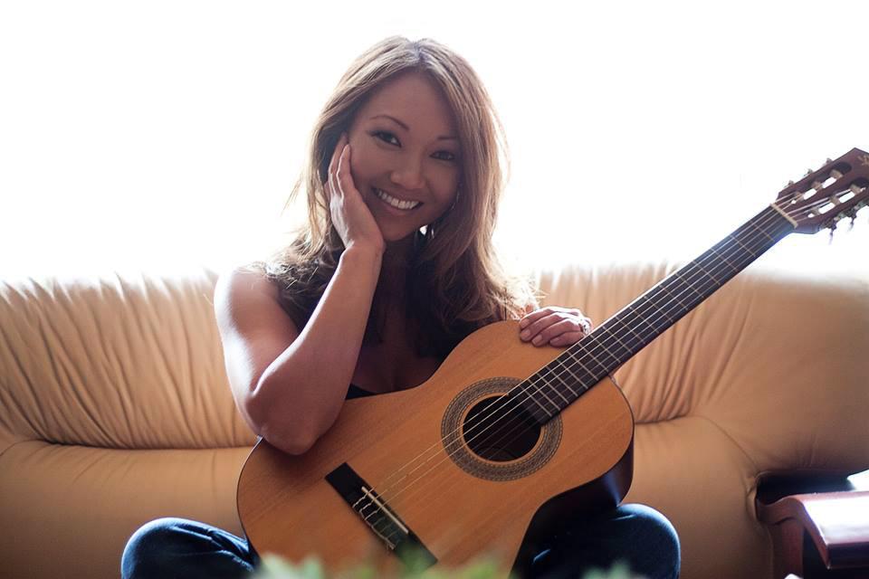Grace De La Rosa, with guitar.