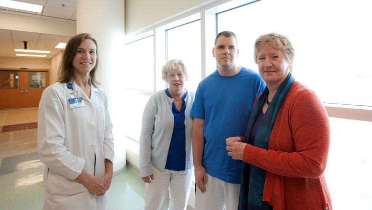 Stroke survivor Sean Bretz (center) with Lisa Lazaraton (far left), a physical therapist at Mayo Clinic in Florida, his mother and aunt (right).