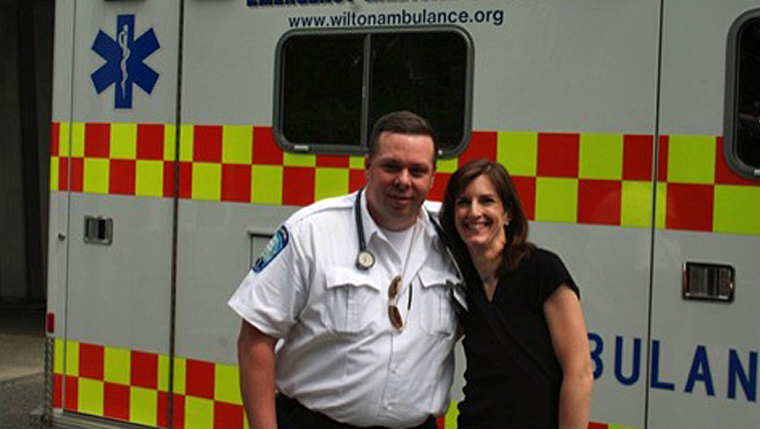 Nancy Capelle with emergency medical technician Mike Szumagala, whose quick actions helped save her life.