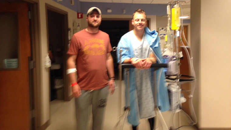 Todd Goldrick, transplant patient, stops for a photo with his donor, Marty Yeager.