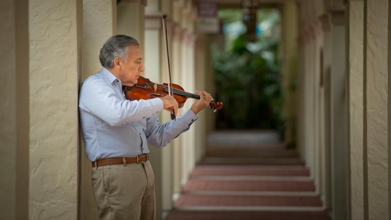 Alvaro Gomez plays his violin.