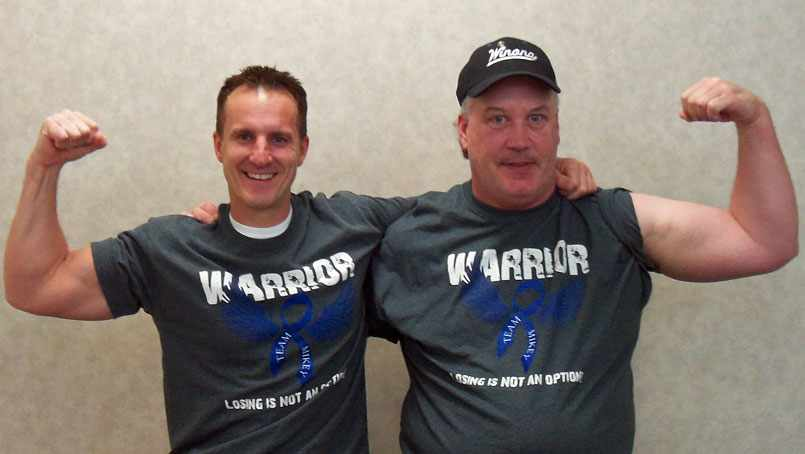 Mike Woellert does the hashtag StrongArmSelfie pose with his doctor, Eric Dozois, M.D., a Mayo colorectal surgeon.