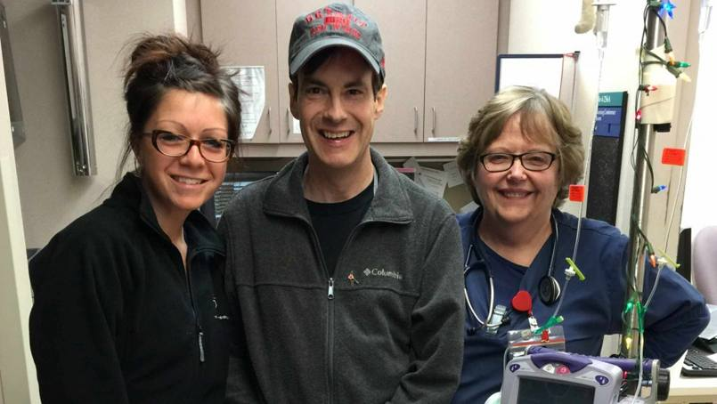 Randy Marlow with two of his transplant nurses.