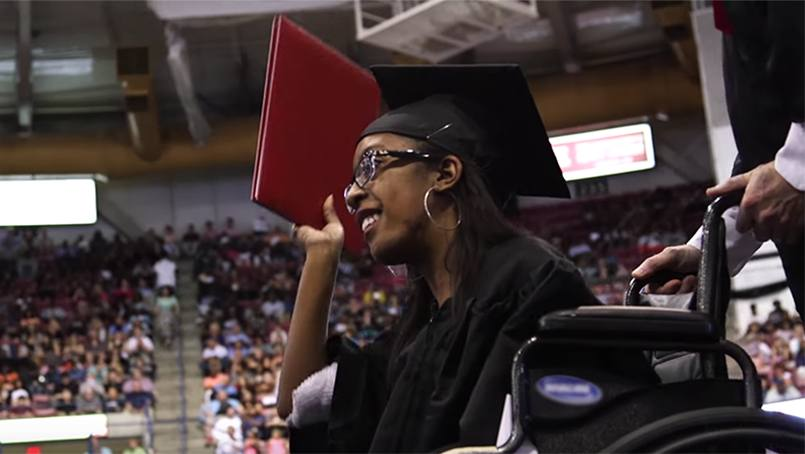 Brentney Simon receiving her associate's degree.