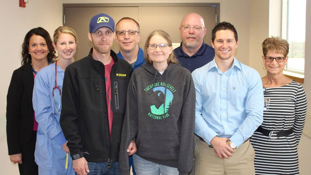 Tabetha and Matt Cameron with members of the team that coordinated Tabetha's medical transport to Mayo Clinic